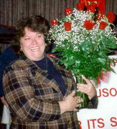 Theresa Dagenhart of Long's Corporation received a dozen red roses